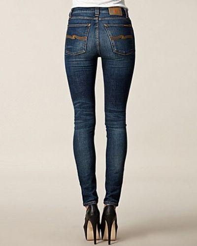Till dam från Nudie Jeans, en blå slim fit jeans.