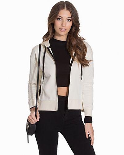 Till dam från Calvin Klein Jeans, en hoodie.