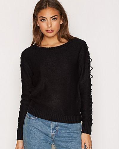 Till dam från Jacqueline de Yong, en svart stickade tröja.