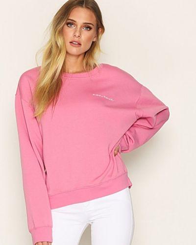 Till dam från Topshop, en rosa sweatshirts.