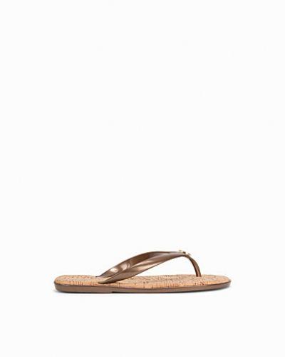 Till dam från MICHAEL Michael Kors, en bronsfärgad sandal.