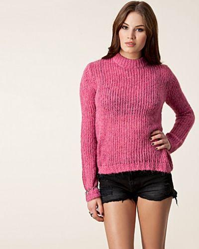 Till dam från Cheap Monday, en rosa stickade tröja.
