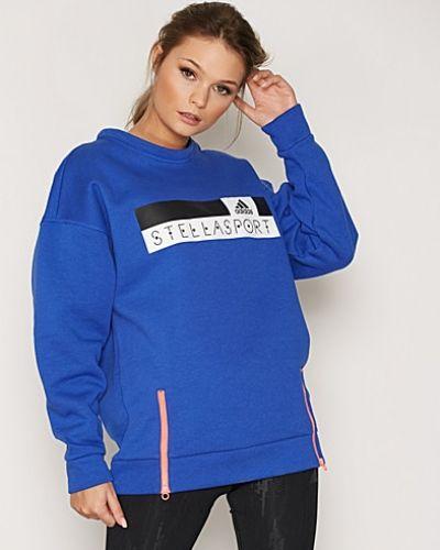 Till dam från adidas StellaSport, en blå sweatshirts.