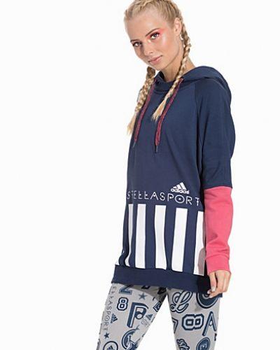Till dam från adidas StellaSport, en lila sweatshirts.