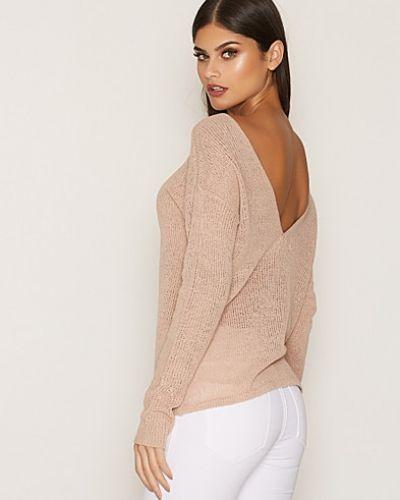 Rosa stickade tröja från NLY Trend till dam.