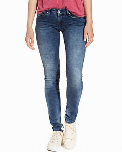 Till dam från Hilfiger Denim, en blå slim fit jeans.