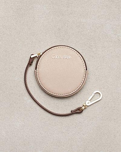 Beige plånbok från Calvin Klein till dam.
