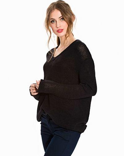 Till dam från Hope, en svart stickade tröja.