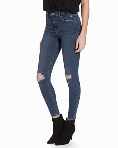Till dam från Topshop, en blå slim fit jeans.