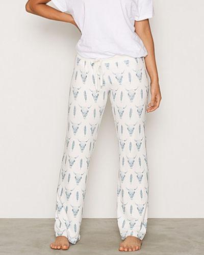 Vit pyjamas från P-J Salvage till dam.