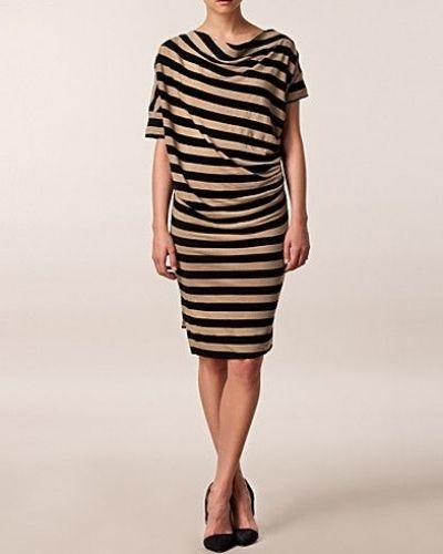 Creamfärgad studentklänning från Vivienne Westwood till tjejer.