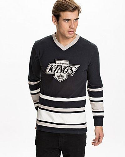 Svart sweatshirts från Mitchell & Ness till killar.