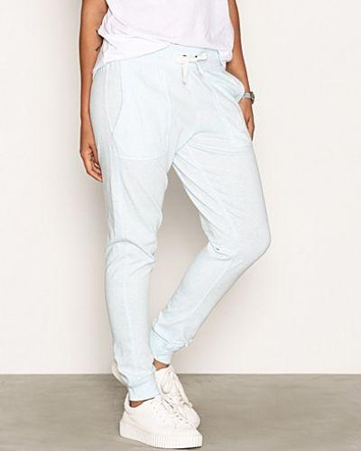 Blå byxa från Nike till dam.