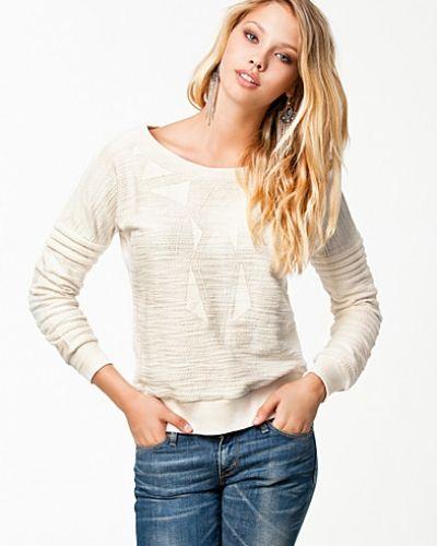 Till dam från Y.A.S, en vit sweatshirts.