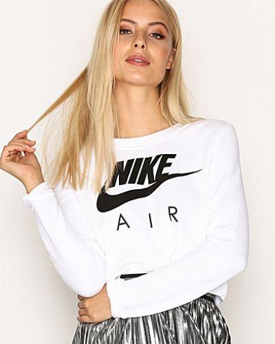 Till dam från Nike, en vit sweatshirts.