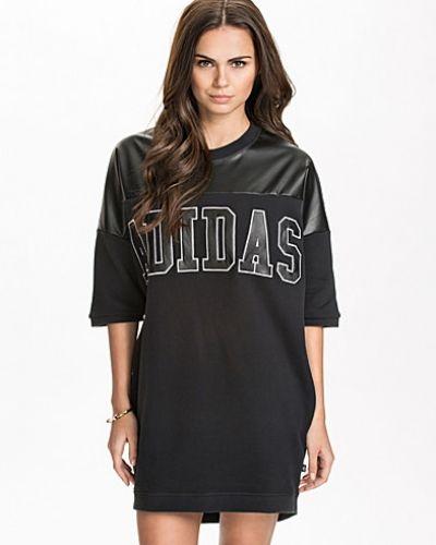 Till dam från Adidas Originals, en svart klänning.