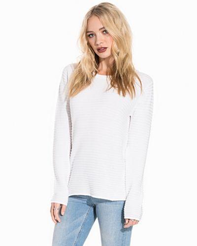 Till dam från B.Young, en vit stickade tröja.