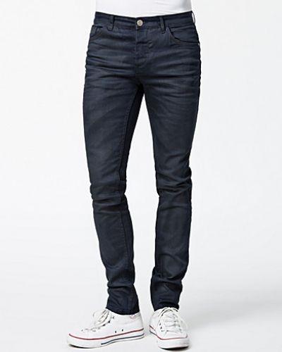 Till herr från Selected Homme, en metallicfärgad slim fit jeans.