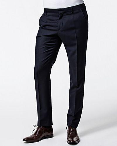 Till herr från Selected Homme, en blå kostymbyxa.