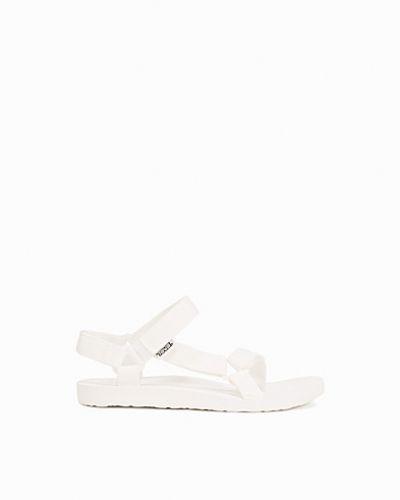Till dam från Teva, en vit sandal.