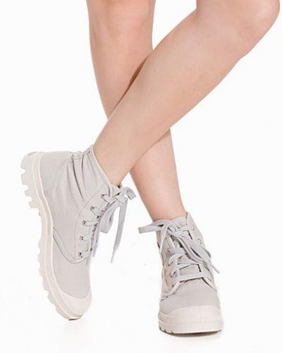 Till dam från Palladium, en sneakers.