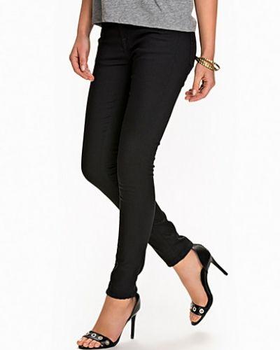 Till dam från Nudie Jeans, en svart slim fit jeans.