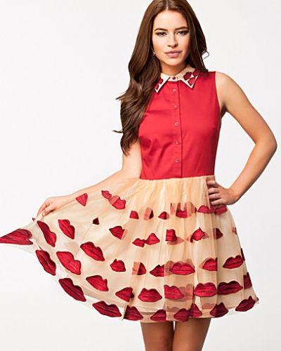 Naturfärgad studentklänning från Alice+olivia till tjejer.
