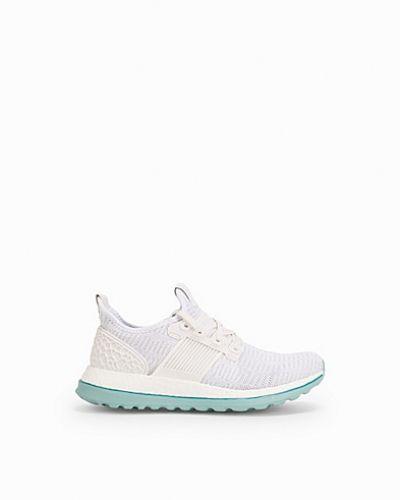 Till dam från adidas Sport Performance, en vit löparsko.