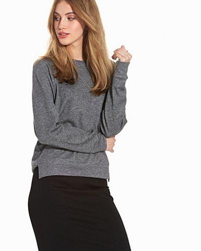 Till dam från Filippa K, en grå tröja.