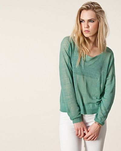 Till dam från Dagmar, en grön stickade tröja.