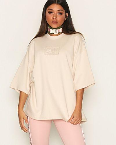 Rosa t-shirts från Puma till dam.