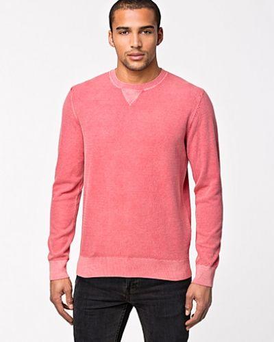 Till killar från Tommy Hilfiger, en metallicfärgad sweatshirts.