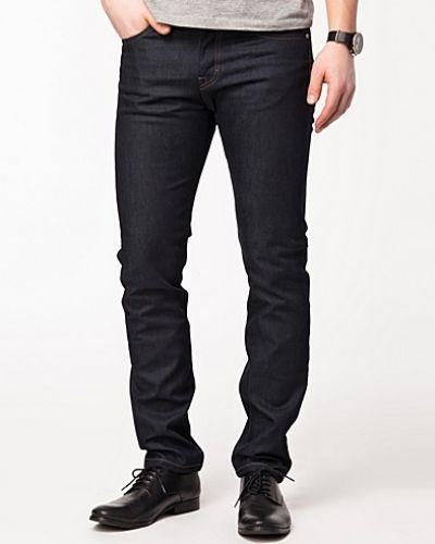 Metallicfärgad slim fit jeans från Filippa K till herr.