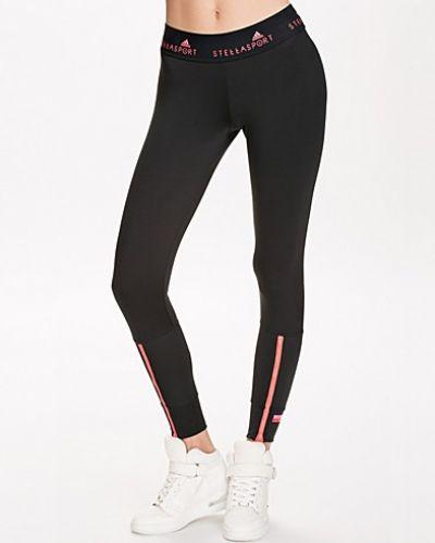 Till dam från adidas StellaSport, en svart träningstights.