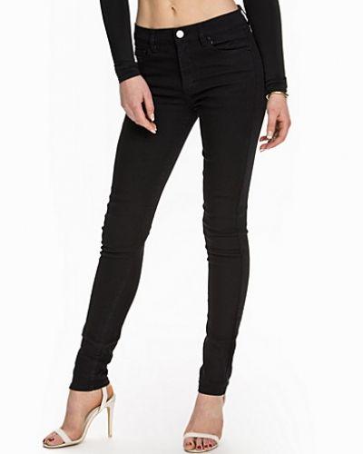 svarta skinny jeans dam