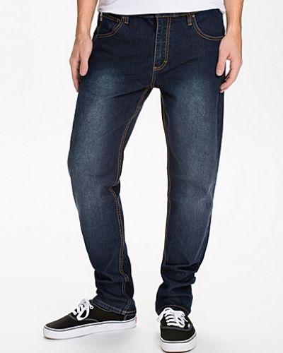 Blå slim fit jeans från Sweet till herr.