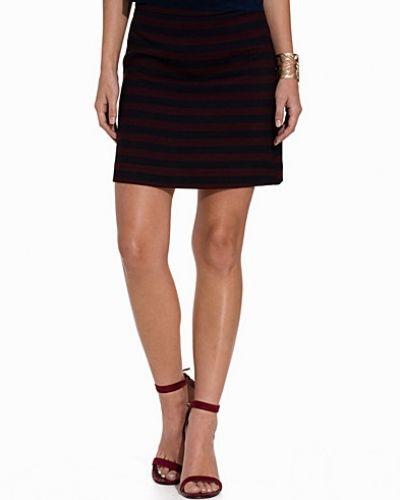 Till kvinna från Miss Selfridge, en flerfärgad minikjol.