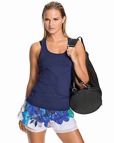 Till dam från Adidas by Stella McCartney, en blå träningslinnen.