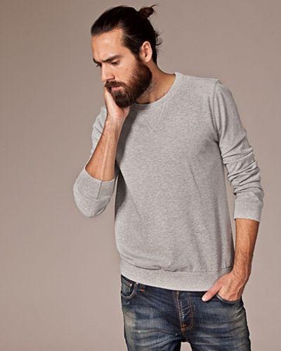 Sweatshirts från Nudie Jeans till killar.