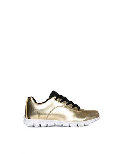 Guld sneakers från Oill till dam.