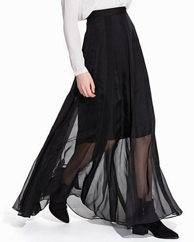 Till kvinna från By Malene Birger, en svart maxikjol.