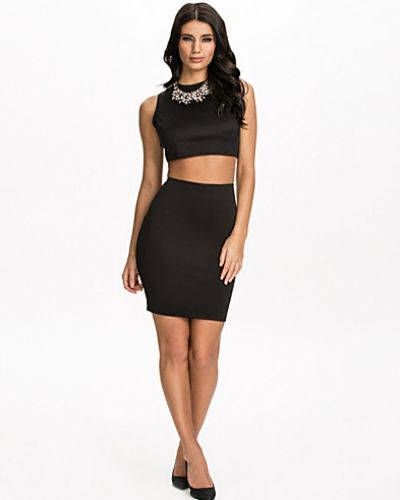 Pencil skirts are meant to be close fitting, but the size should be chosen carefully. Often, the perfect fit can only be achieved with some simple tailoring. Alterations to take in a seam or a waistband are inexpensive and well worth it.