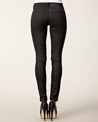 Tight Hard Coated Jeans Cheap Monday slim fit jeans till dam.