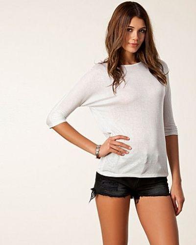 Till dam från Cheap Monday, en vit t-shirts.