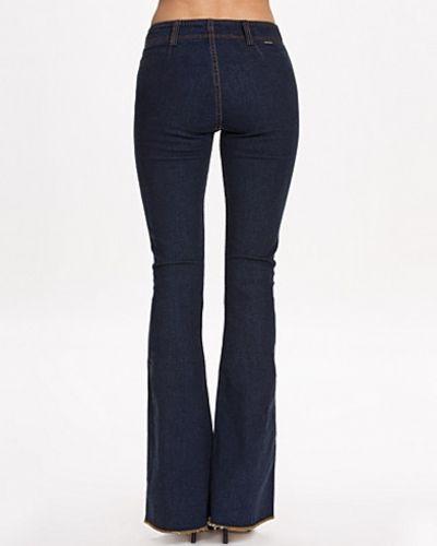 gul och blå jeans återförsäljare
