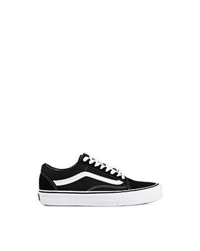 Till dam från Vans, en svart sneakers.