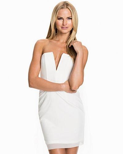 Fodralklänning från Rebecca Stella For Nelly till dam.