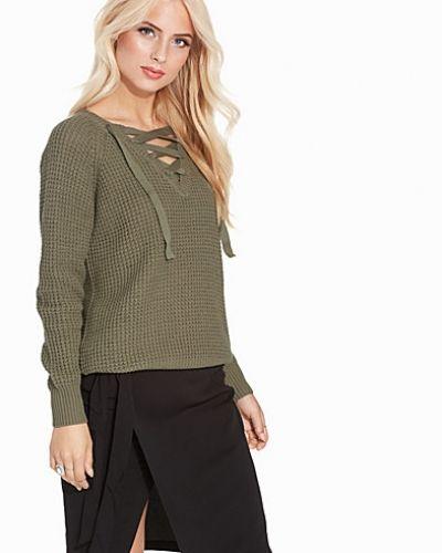 Till dam från VILA, en grön stickade tröja.