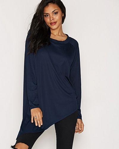 Till dam från Vero Moda, en blå oversize-tröja.