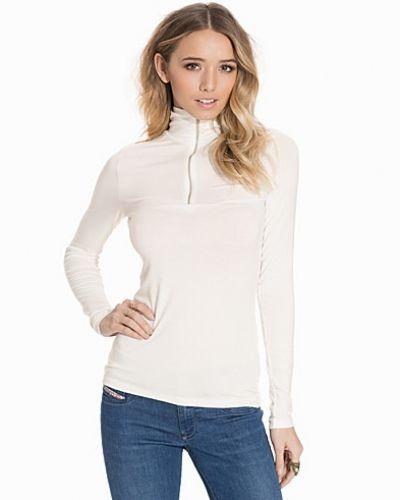 Vit stickade tröja från Vero Moda till dam.